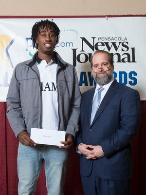 Pensacola High School boys basketball player and scholarship winner Shawndarius Cowart, left, with sponsor Troy Rafferty during the annual Pensacola News Journal All-Sports Awards banquet in Pensacola on Monday, June 11, 2018.