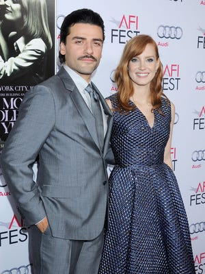 """Oscar Isaac and Jessica Chastain arrive at the AFI Fest premiere of """"A Most Violent Year."""""""