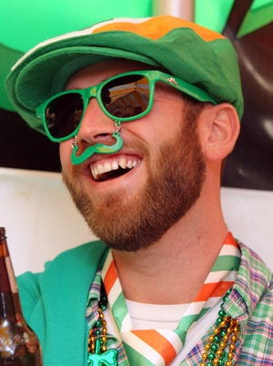 George Gripshover, of Florence, has a laugh with friends as he celabrates St. Patrick's Day celebration at Molly Malone's Irish Pub,  Covington. The festivities began at 6 a.m.