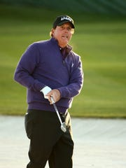 Phil Mickelson watches his second shot from a fairway