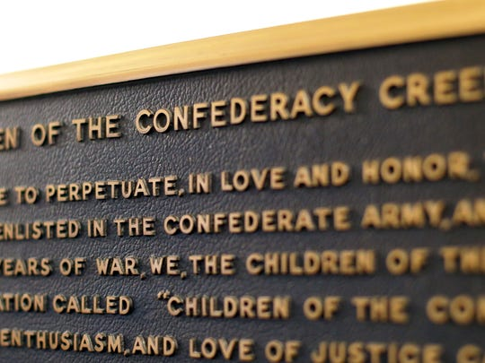 A Confederate plaque is displayed near the Rotunda