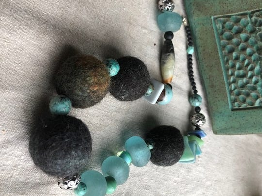 Jewelry with alpaca fiber beads by Stan and Janette Bauer at Turtle Ridge Gallery.