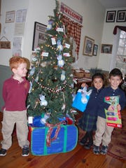 Whitehouse Prep students helping with the Giving Tree.