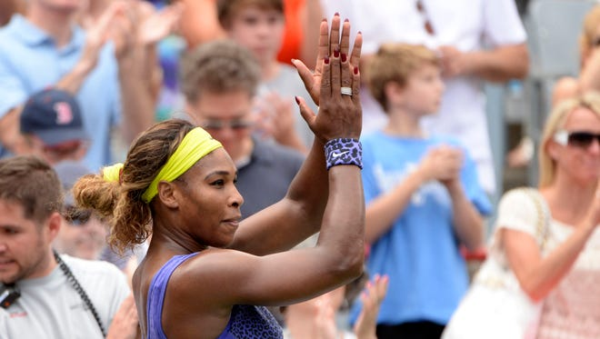 Serena Williams (USA) acknowledges the crowd after her match against Caroline Wozniacki (DEN) on day five of the Rogers Cup tennis tournament at Uniprix Stadium.