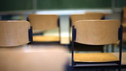 A stock image of a school classroom.
