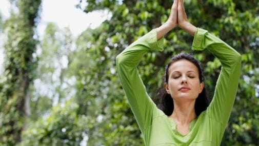 White Plains' Outdoor Yoga on Court Street event is back for another year, with dozens of people expected to bend and stretch between Main Street and Martine Avenue beginning at 7 p.m. on June 22, 2016.