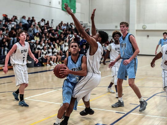 Rancho Mirage's Tyler Robinson goes for the basket