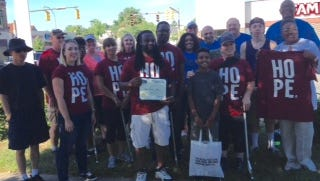 """Volunteers from The Father's House church participated in neighborhood cleanup as part of a """"Day of Hope."""""""