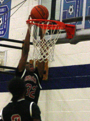 Churchill's Jerron Hampton ascends for a near dunk
