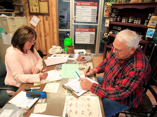 Bob Herman fills out a form to donate his deer with the help of Bobbi Archer, Sunday, November 17, 2013, at Archer's Meat Processing at 259 South Meridian Street in Greenwood. The donated deer go to the state's venison food bank program.