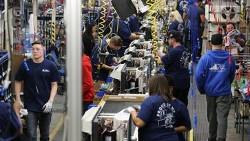 Workers at General Electric Appliance Park's Building 2 assemble the new Zoneline air conditioner. February 9, 2016
