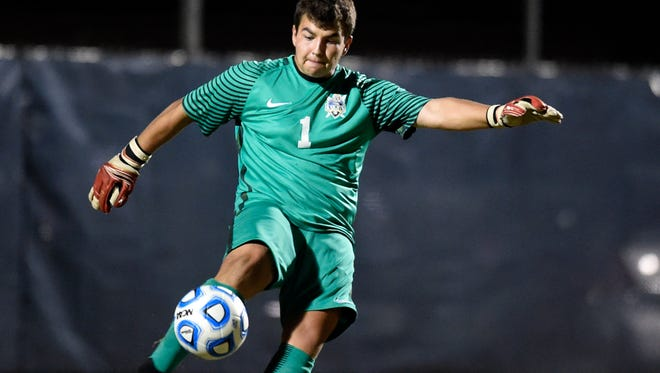 Castle goalkeeper Michael Bertram kicks the ball to mid-field during the first half of the Class 2A boys' soccer sectional championship match at Traylor Family Stadium in Evansville Saturday.  Memorial won the championship 2-1.