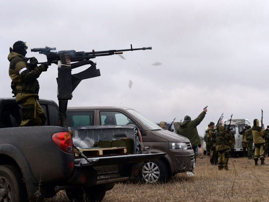 Pro-Russian separatists fire shots in the air during