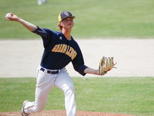 Grand Ledge pitcher Wyatt Rush throws against Portage