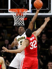 Iowa forward Tyler Cook shoots over Ohio State center Trevor Thompson (32) on Saturday at Carver-Hawkeye Arena.