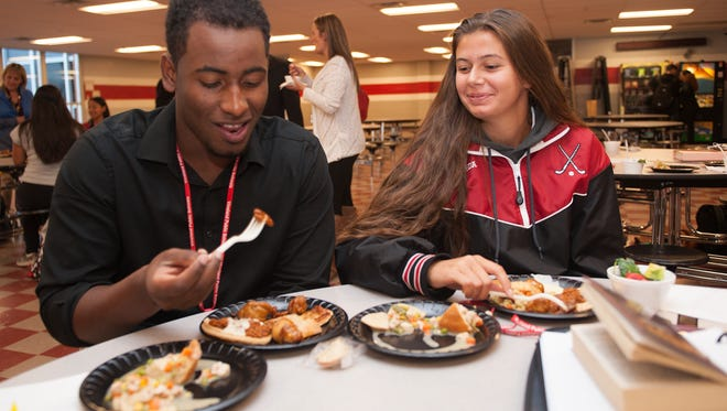 Students Jose Mateo and Alexis Pineda share a meal at Vineland High School cafeteria.