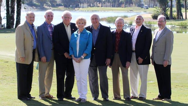 From left, Jim Boesch, Roger Strelow, Phil Douglas, Marilyn Edwards, Nick Batos, Don Eslick, Howard Levitan, Bob Lienesch.