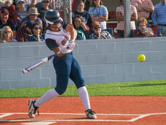 St. Thomas More's Katelyn Norse swings at the ball