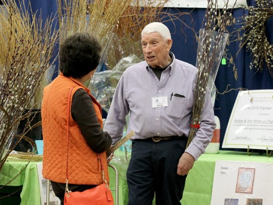 Walker Miller of Happy Berry Farm in Six Mile talks to a customer at the 40th annual Upstate's Home & Garden Expo in the Civic Center of Anderson. The event runs through the weekend.