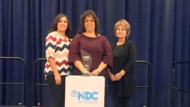 Priscilla Lucero, middle, was happy for receiving an economic development award for the Grant County Water Project which will bring together 11 public and private entities to address the severe water shortage.