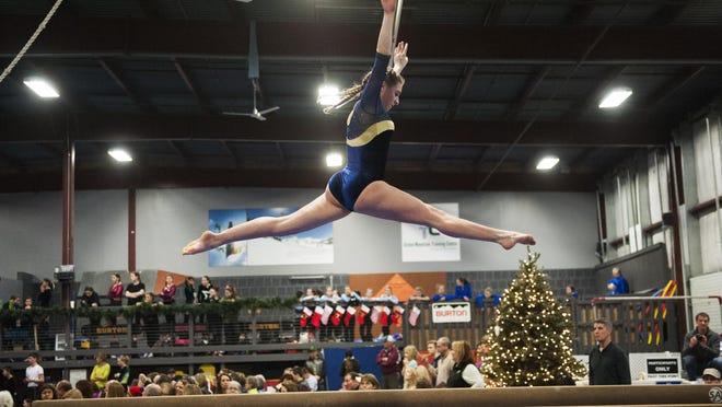 Essex's Eve Contois competes in the beam routine during the Rebel Holiday Invitational gymnastics meet earlier this month.