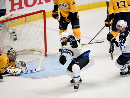 Winnipeg Jets center Mathieu Perreault (85) celebrates his goal with Winnipeg Jets left wing Nikolaj Ehlers (27) who got the assist during the third period of Game 5 of the second round NHL Stanley Cup Playoffs at Bridgestone Arena, Saturday, May 5, 2018, in Nashville, Tenn.