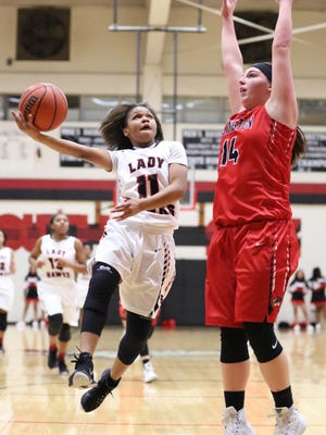 South Side's Quanardra Miller drives to the basket as Lexington's Katilyn Kelley tries to defend on Tuesday.