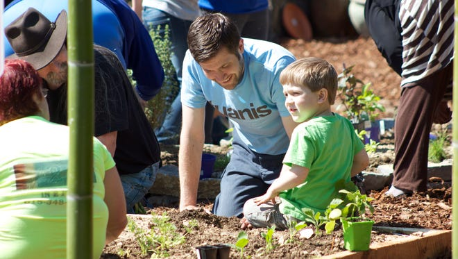 Joshua and Ephram Southards take part in Journey to Health's Inaugural Spring Planting.