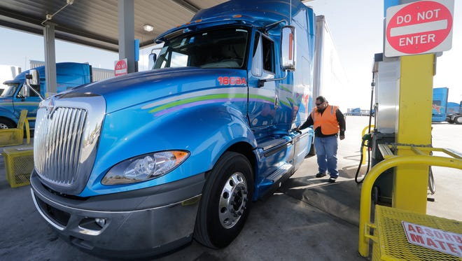Mesilla Valley Transportation driver George Corral refuels his truck at the company's large truck terminal at 9525 Escobar in East El Paso.