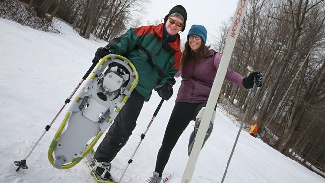 Democrat and Chronicle reporters Patti Singer, left, and Victoria Freile, right, take to the snow with snowshoes and cross-country skis at Powder Mills Park in Perinton Tuesday, Jan. 12, 2016.