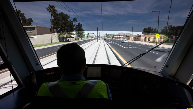 A view behind a Valley Metro light rail operator's seat in Phoenix. Phoenix Mayor Greg Stanton, Phoenix City Council members, station artists and community members got a sneak peek at Valley Metro's northwest light rail expansion. The expansion is open to the public Saturday, March 19.