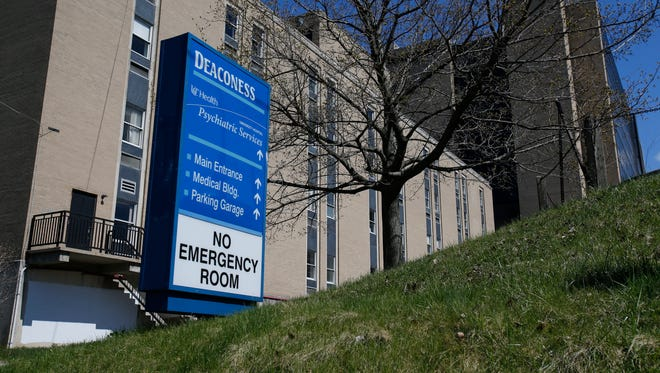The Deaconess Hospital building in University Heights, pictured, Monday, March 21, 2016, will be sold. UC Health is planning by this fall to bring its inpatient mental health care unit out of Deaconess Health Campus back to the main hospital, officials said Monday.