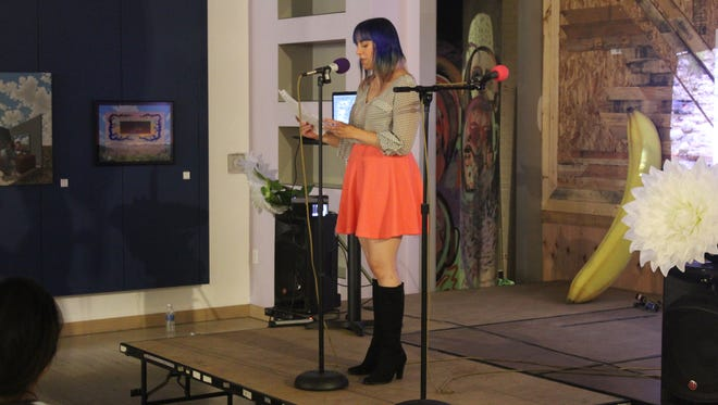 Leanne Kathleen Daniele performs at Poetry Fest, organized by Michelle Castillo and Coachella Valley Art Scene in the MAKE space on July 8, 2016.
