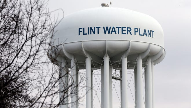 The Flint Water Plant tower is seen Feb. 5, 2016 in Flint, Mich.  Michigan Gov. Rick Snyder defended how his office responded to an email flagging a potential link between a surge in Legionnaires' disease and Flint's water, saying an aide asked for further investigation but a state agency did not bring forward the issue again.