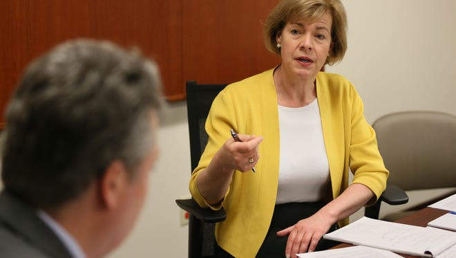 U.S. Sen. Tammy Baldwin speaks with Milwaukee Ald. Michael Murphy (left) about the opioid problem in Milwaukee and efforts to combat it. Baldwin was holding a round-table discussion Monday at Lisbon Avenue Health Center on the opioid crisis with a variety of people who are on the front lines of the epidemic.