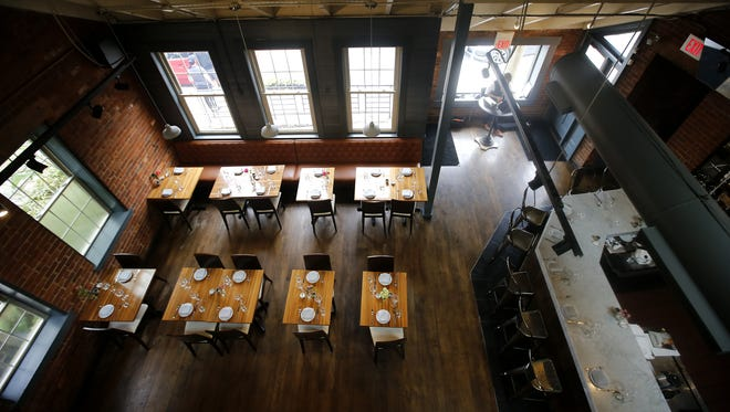 General view of the main dining room and bar, pictured, Friday, April 28, 2017, at Eighth and English restaurant in Cincinnati.