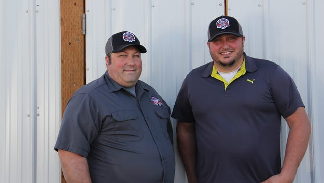 Dan Miletta and William Mary stand outside their new brewery space on 22nd Street. Ratchet Brewery is set to open this fall.