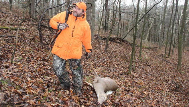 Mark Morell of Oakfield, Wis. prepares to drag a white-tailed deer he shot while hunting near Sextonville in Richland County on Saturday, opening day of the 2017 Wisconsin gun deer season.