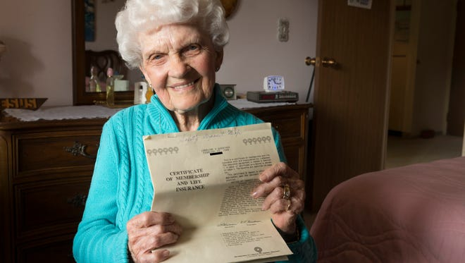 Lorraine Guenther will be 98 next month and she's been told she has outlived her life insurance. After paying $500 a year since 1988, the cash value is gone and the death benefit is gone. She wants a refund. She is shown Wednesday, March 28, 2018 at her apartment in Wauwatosa, Wis. Guenther's policy number has been obscured.