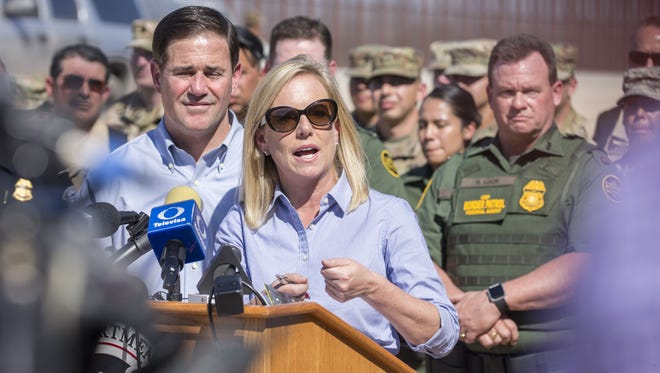U.S. Secretary of Homeland Security Kirstjen Nielsen, along with Arizona Gov. Doug Ducey, answers questions during a press conference after a tour of the border in San Luis, Arizona, on April 18, 2018.