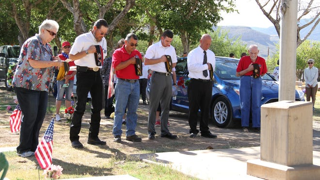 VFW Post 7686 past Chaplain Karen Forsythe (L) said a prayer Monday to honor fallen veterans on Memorial Day. From her left, VFW Post 7686 members Warren G. Booker, Andy Garcia, Sean Core and Gary Townsend.
