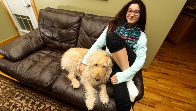 Ireland Hobert Hoch, 13, shown with her dog, Fawn, refused to be weighed in school as part of the school's regular body mass index testing of students and was sent to the principals office. PE teachers and health officials say that in a nation of obese
