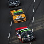 Ben Rhodes, driver of the No. 32 Alpha Energy Solutions Chevrolet, leads John Wes Townley and Brian Ickler during Sunday's NASCAR Camping World Truck Series Kroger 250 at Martinsville Speedway.
