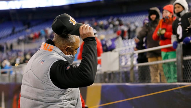 Cincinnati Bengals head coach Marvin Lewis throws his cap to a fan as he walks to the end zone after the NFL Week 17 game between the Baltimore Ravens and the Cincinnati Bengals at M&T Bank Stadium in Baltimore on Sunday, Dec. 31, 2017. The Bengals won 31-27 in the regular season finale.