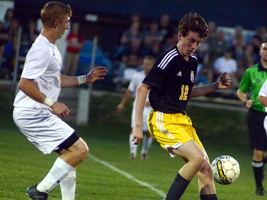 Merrol Hyde Magnet junior Josh Hayward gains possession during first-half action. Hayward scored two second-half goals in the Hawks' 5-1 victory on Tuesday evening.