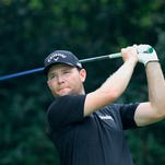 Branden Grace of South Africa tees off on the 5th hole