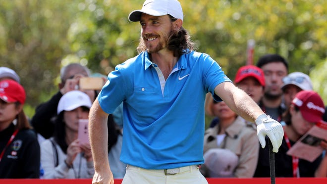 Tommy Fleetwood prepares to tee off at the HSBC Champions golf tournament held at the Sheshan International Golf Club in Shanghai on Friday, Nov. 1, 2019. (AP Photo/Ng Han Guan)