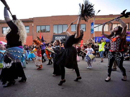 """Teachers and students from Dance, Ltd. School of Dance perform Thursday during ArtWalk Oct. 12, 2017. Halloween costumes, dance troops, and health emergency response teams were on display during the monthly event called """"The Art of Response: Zombie Preparedness."""""""