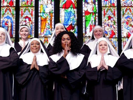 """Alexandra St. James-Gray, center, stars in """"Sister Act"""" at the Des Moines Community Playhouse."""
