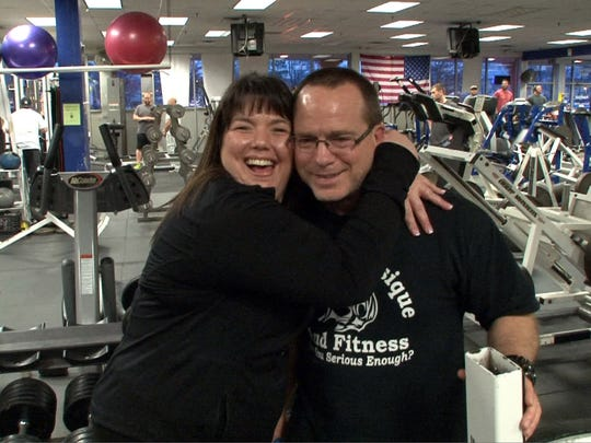 Lee Ann Ray shares a hug with her trainer Kent Bierly at Pure Focus Sports Club in Brick, Monday evening, April 4, 2016.